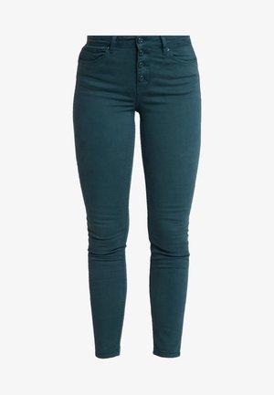 SARGA - Trousers - greens