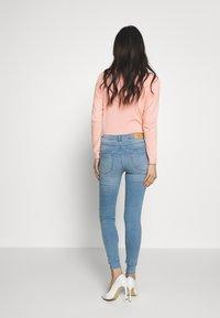 Springfield - Slim fit jeans - light blue - 2