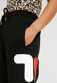 Fila Petite - PUREPANTS - Tracksuit bottoms - black - 5
