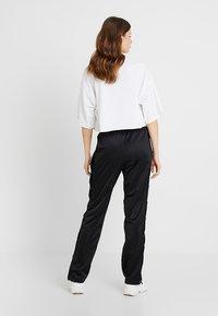 Fila Tall - GERALYN TRACK PANTS - Pantalones deportivos - black - 2