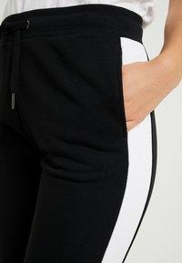 Fila Tall - FREYA SLIM  - Pantalones deportivos - black/bright white - 5