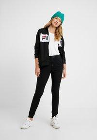 Fila Tall - FREYA SLIM  - Pantalones deportivos - black/bright white - 1