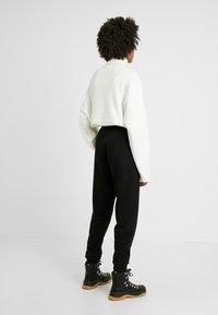 Fila Tall - PURE PANTS - Spodnie treningowe - black - 3