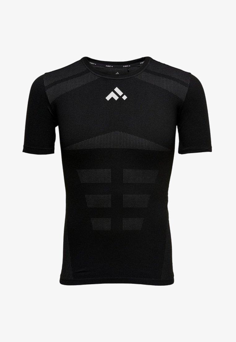FIRST - NAHTLOSES - T-shirt print - black