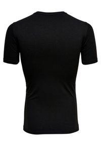 FIRST - NAHTLOSES - T-shirt z nadrukiem - black - 1