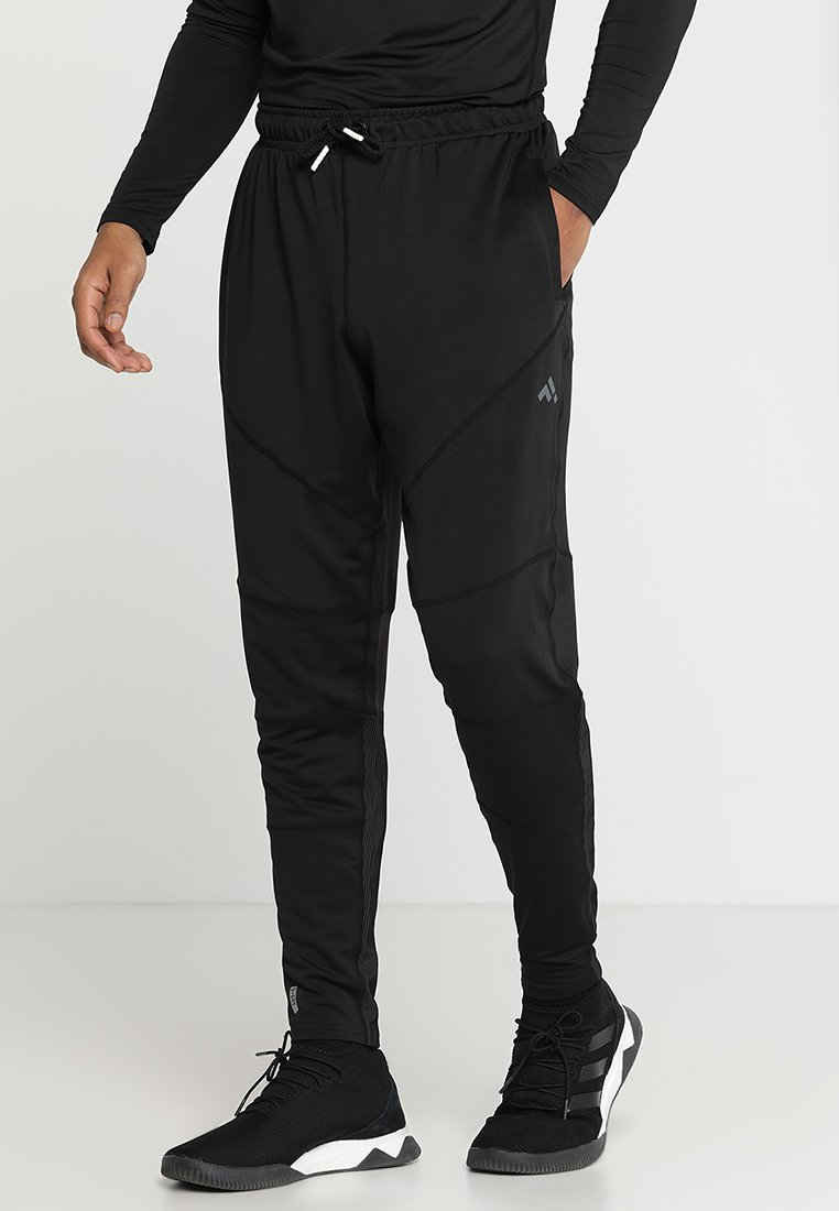 FIRST - TRAINING PANTS - Tracksuit bottoms - black