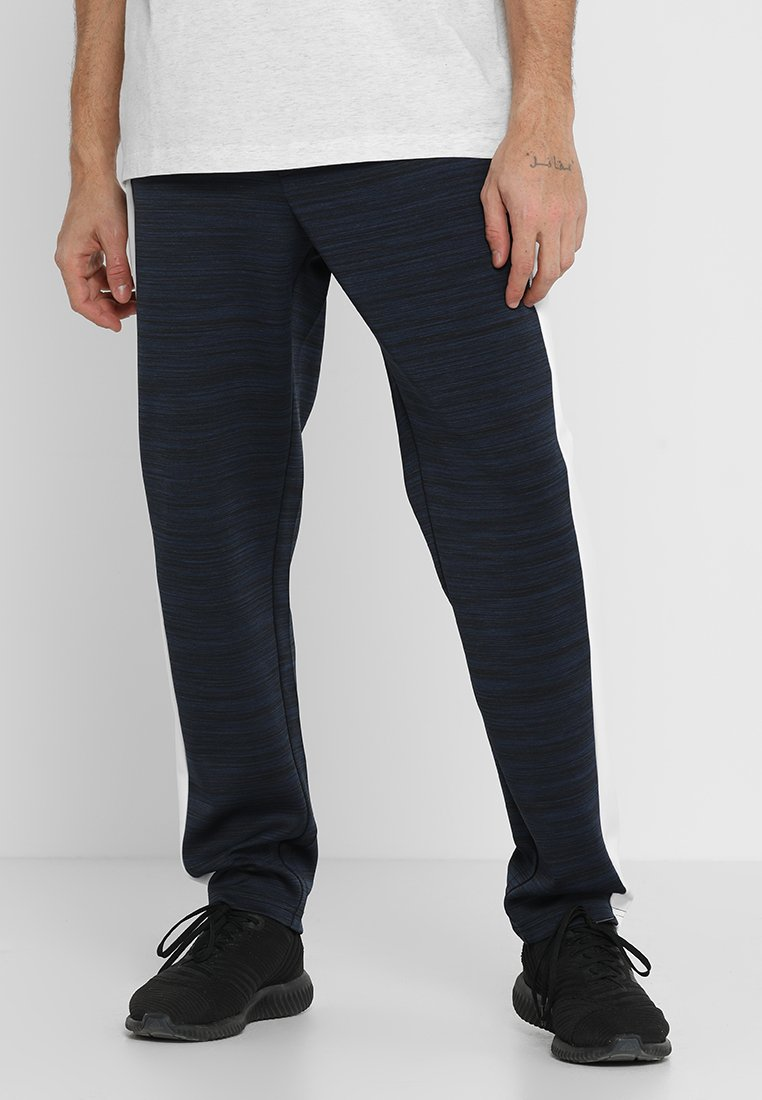 FIRST - FRSNOLAN PANTS - Tracksuit bottoms - blue nights melange/white