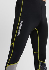 FIRST - FRSASK TRAINING  - Legginsy - black/blazing yellow - 6