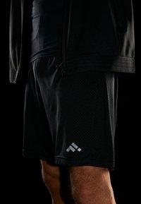 FIRST - FRSKILAY TRAINING SHORTS  - Krótkie spodenki sportowe - black - 4