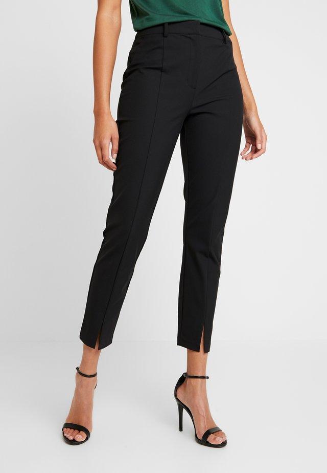 MIKA SPLIT - Pantalones - black