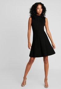 Forever New - FIT AND FLARE DRESS - Pletené šaty - black - 2