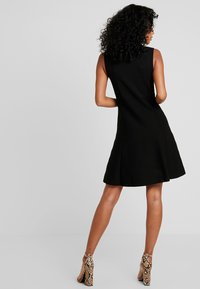 Forever New - FIT AND FLARE DRESS - Pletené šaty - black - 3