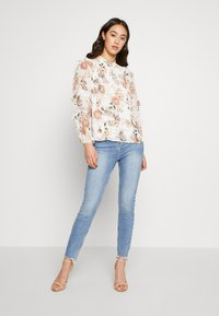 Forever New - ORINTHIA RUFFLE TRIM BLOUSE - Blouse - off-white - 1