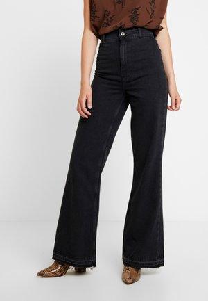 MINDY RIGID - Flared jeans - black
