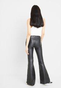 Free People - PENNY PULL ON VEGAN - Pantalon classique - black - 2