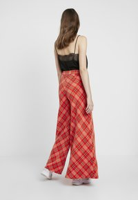 Free People - WONDERLAND WIDE LEG - Pantaloni - red - 3