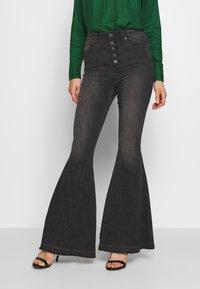 Free People - IRREPLACEABLE FLARE - Jeans a zampa - black - 0
