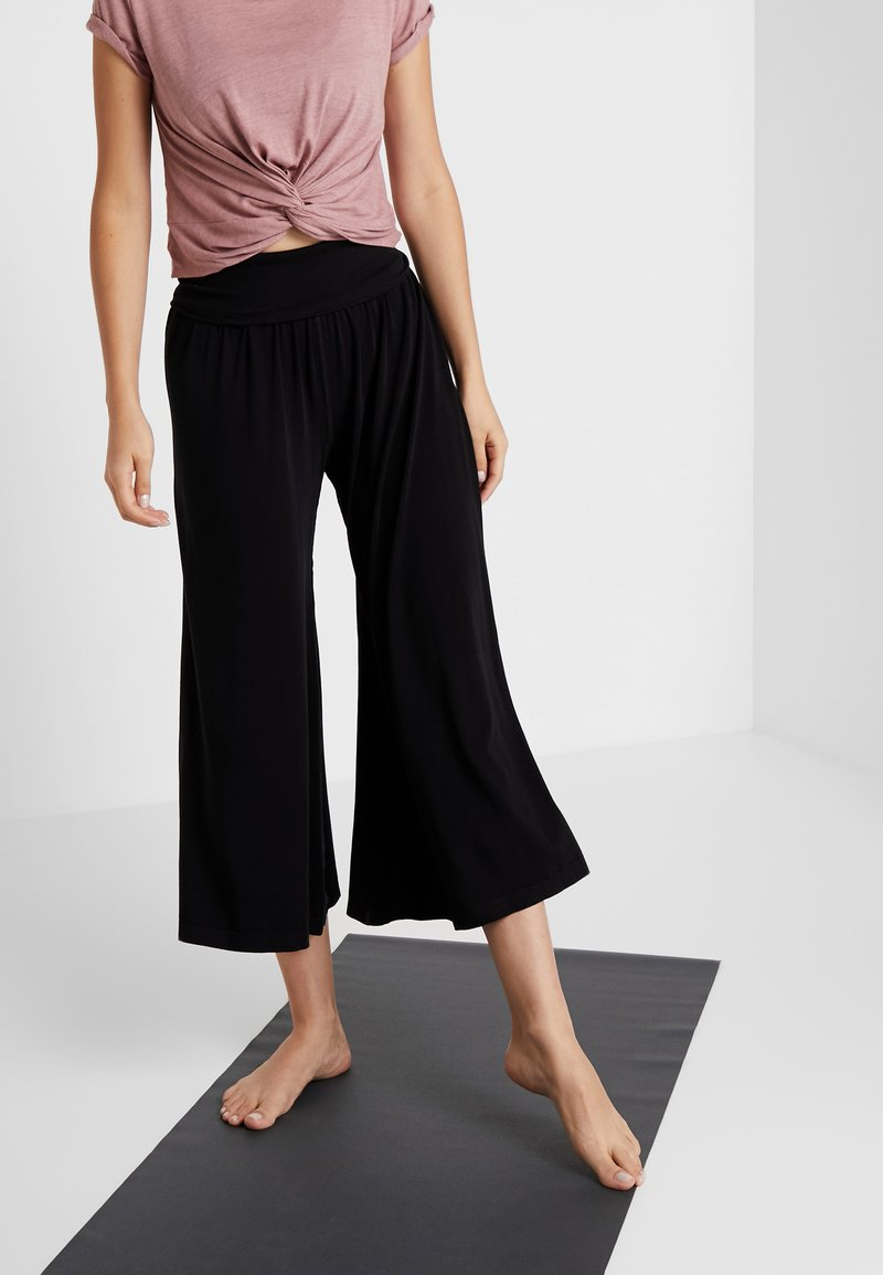 Free People - WILLOW WIDE LEG PANT - Tracksuit bottoms - black