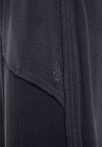 Free People - FP MOVEMENT TREKKING OUT JOGGER - Tracksuit bottoms - black - 5