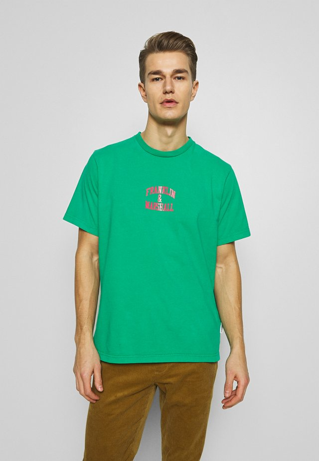 T-shirts med print - bright mint
