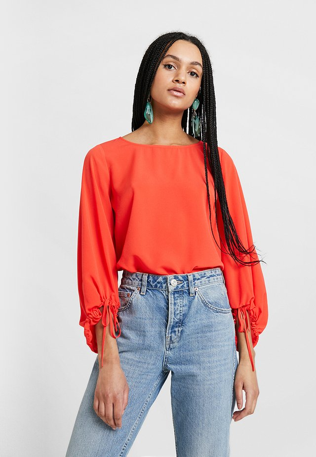 CREPE SLID PUFF  - Blus - fire coral