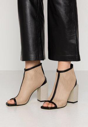 FATIMA - High heeled ankle boots - nero/beige