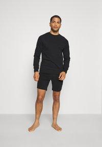 Frescobol Carioca - LEBLON LOUNGE - Pyjama bottoms - black - 1