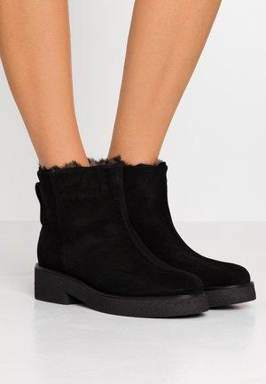 GRETA  BOOT - Platform ankle boots - onyx