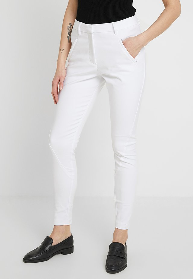 ANGELIE - Trousers - white