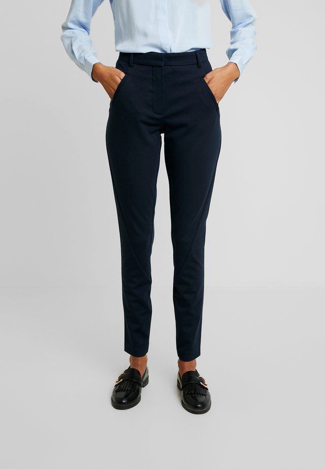 ANGELIE - Trousers - navy zinni