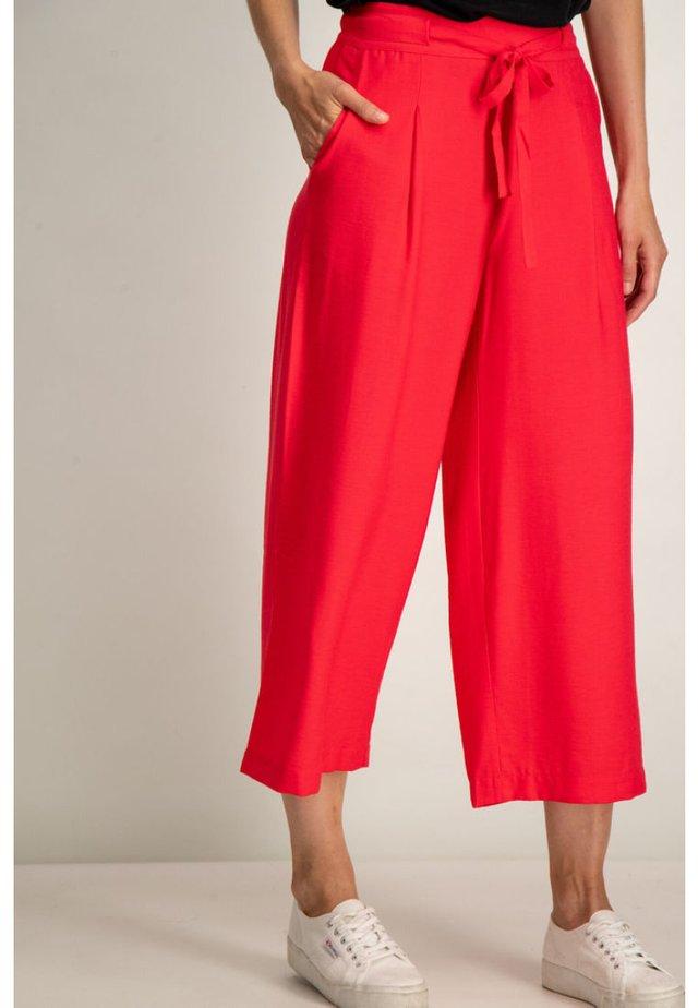 Trousers - tomato puree