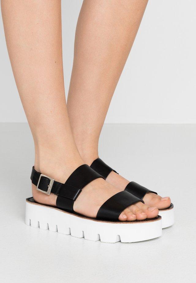 ASTRID - Korkeakorkoiset sandaalit - black