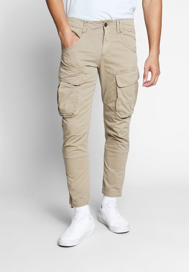 RUFO - Pantalon cargo - sand