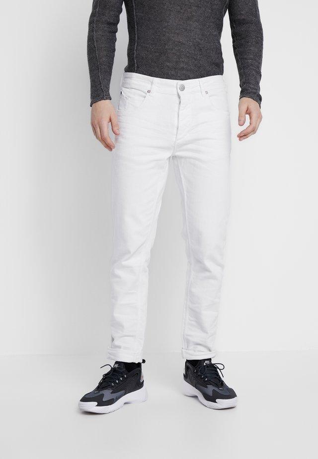 Jeans fuselé - white denim