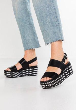 SERRES - Korkeakorkoiset sandaalit - black