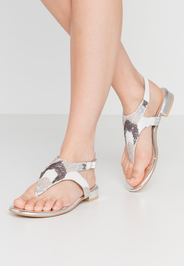 NORLINA - T-bar sandals - white