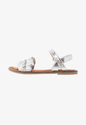 Sandaalit nilkkaremmillä - plata