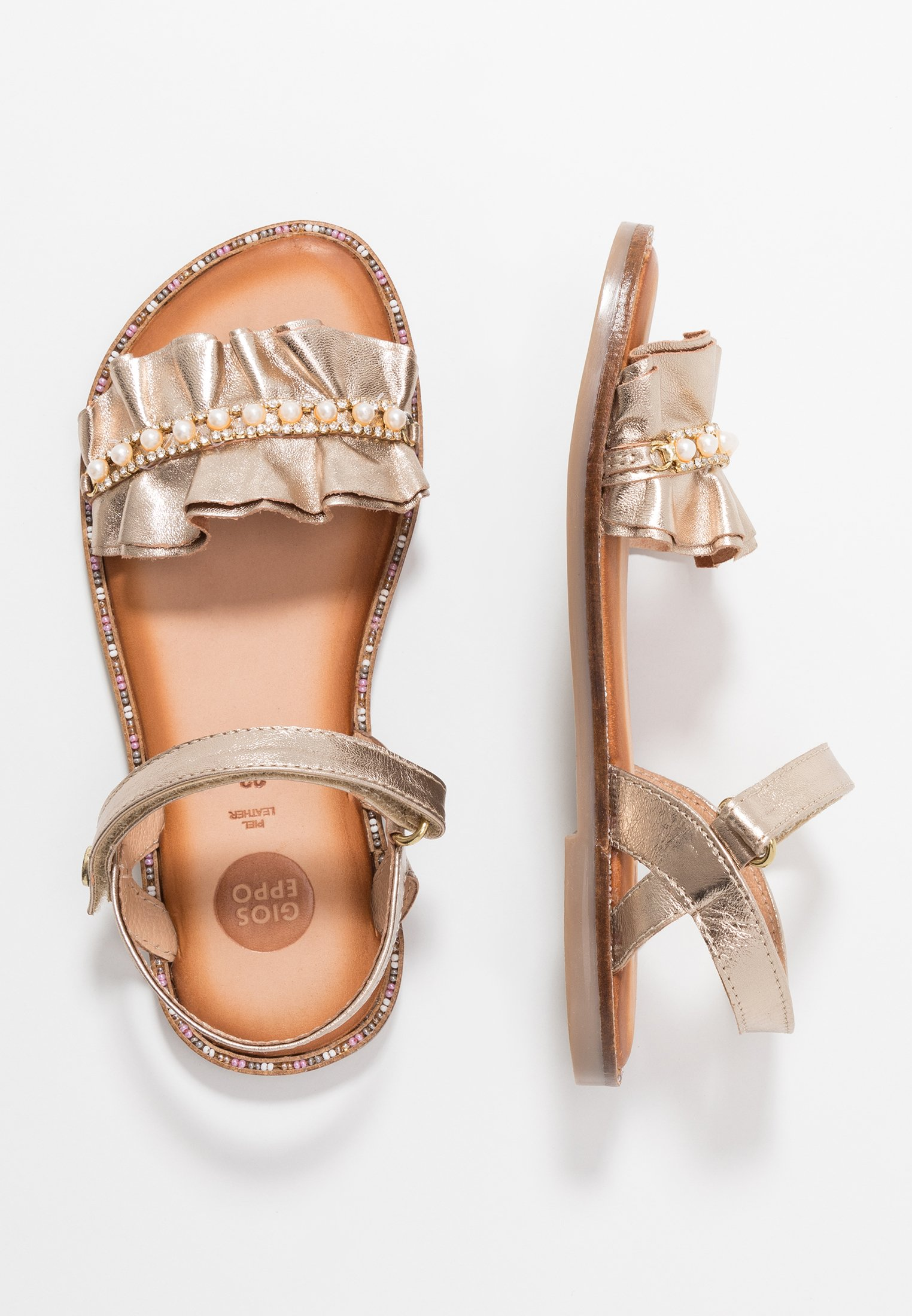 Sandaalit nilkkaremmillä gold
