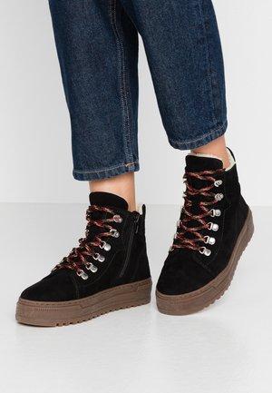 Winter boots - schwarz/natur
