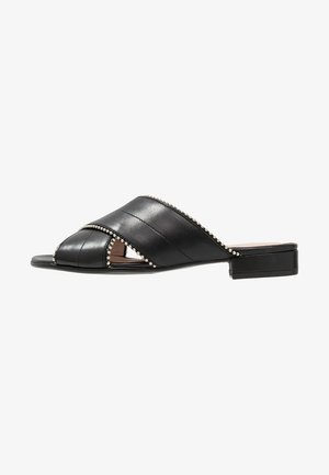PANNEA - Pantolette flach - black