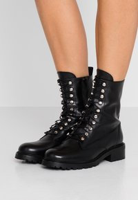 Gardenia - LIVA - Lace-up ankle boots - black - 0