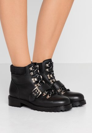 LARA - Cowboy/biker ankle boot - black aragon