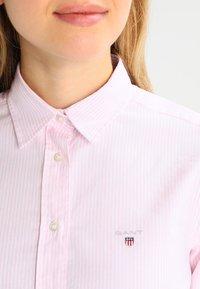 GANT - OXFORD BANKER - Button-down blouse - light pink - 3