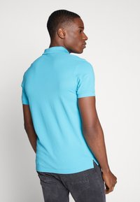 GANT - SOLID RUGGER - Polo - light blue - 2
