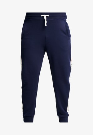 ARCHIVE PANTS - Pantaloni sportivi - evening blue