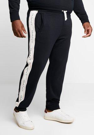 ARCHIVE PANTS - Spodnie treningowe - black
