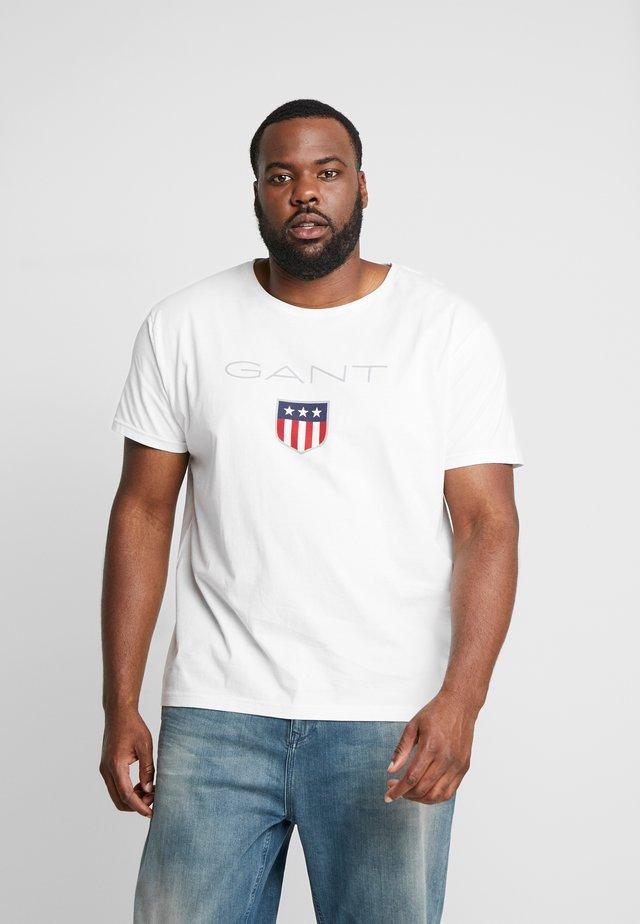 PLUS SHIELD - Camiseta estampada - eggshell
