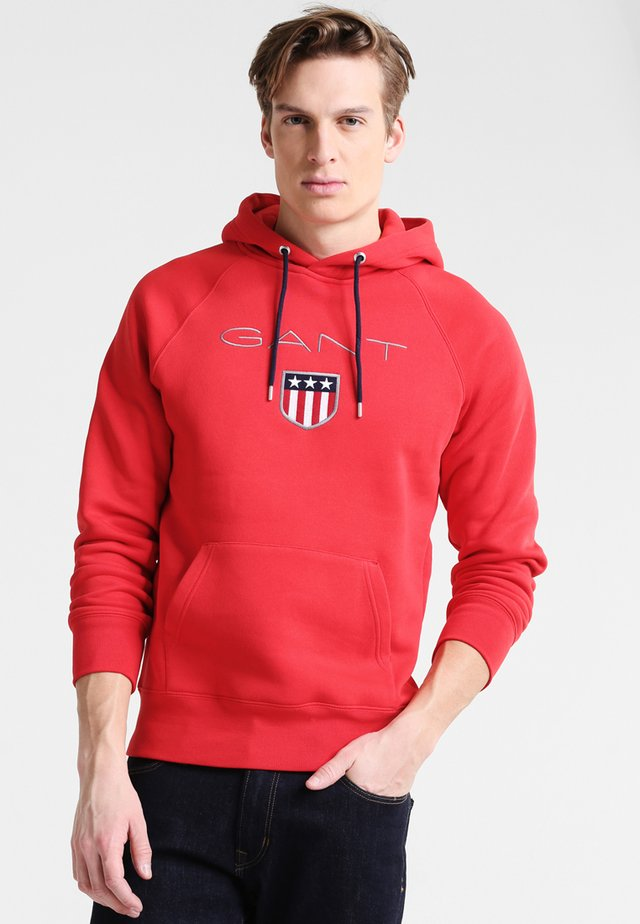 SHIELD HOODIE - Jersey con capucha - bright red