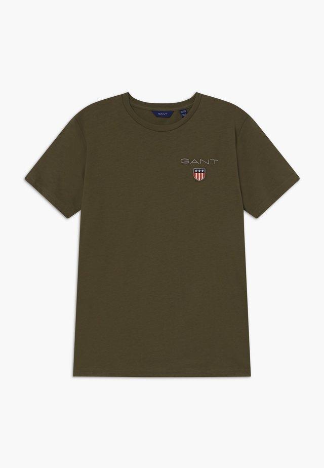 MEDIUM SHIELD - T-shirts - sea turtle