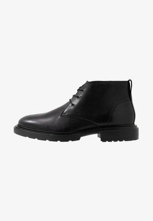 WILLY DESERT - Sznurowane obuwie sportowe - black